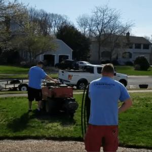 Irrigation technicians installing a sprinkler system in Medfield